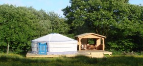 yurt in field